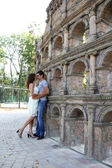 Young couple lovers near copy of Coliseum — Stock Photo
