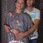 Couple in love embracing in studio — Stock Photo