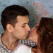 Stock Photo: Young happy kissing amorous couple