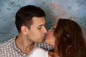 Young happy kissing amorous couple — Stock Photo