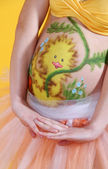 Pregnant woman's belly with a picture, body art — Foto Stock