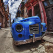 Stock Photo: Abandon old car in street of Havana