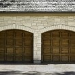 Typical two car wooden oak car garage — Stock Photo #13374374