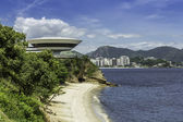 Museum of Contemporary Art against city of Niteroi, Brazil — Stok fotoğraf