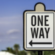 An image of a one way road sign - Stock Photo