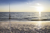 Fishing pole against ocean — Stock Photo