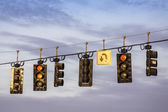 Traffic lights hanging above street — Stock Photo
