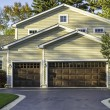 Stock Photo: Traditional AmericHome with Garage