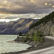 Stock Photo: Curved asphalt road in high mountains of Alaska
