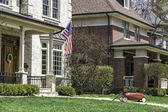 American home with us flag — Stock Photo