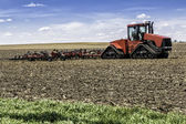 Farm with tractor — Stock Photo