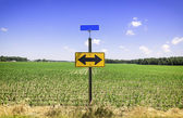 Directional arrow road sign — Stock Photo