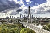 Warsaw skyline behind the bridge — Stock Photo