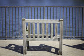Empty wooden bench — Stock Photo