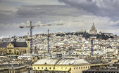 Paris under construction with Sacre Coeur Basilica on the hill — Stock Photo