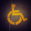 Stock Photo: Disabled icon on broken asphalt