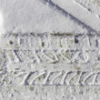 Stock Photo: Car tire imprint in snow