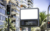 Blank street sign with tropical background — Stock Photo