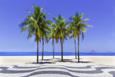 Copacabana beach with palms and sidewalk in Rio de Janeiro, Brazil — Stock Photo