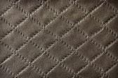 Vintage leather texture with diamond pattern decoration — Stock Photo