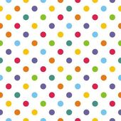 Vector seamless pattern with corolful polka dots on white background — Stock Vector