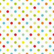 Stock Vector: Seamless vector pattern or texture with colorful polkdots on white background
