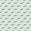 Seamless vector pattern, background or texture with dark brown curly vintage retro gentleman mustaches on mint green background. For hipster websites, desktop wallpaper, blog, web design. — Stock Vector