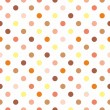 Seamless vector pattern, background or texture with colorful yellow, orange, pink, brown and beige polka dots on white background. — Cтоковый вектор