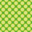 Seamless vector pattern or texture with yellow green polka dots on fresh spring green background for kids background, desktop wallpaper and website design — Stock Vector