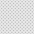 Seamless vector pattern with black polka dots on grey background. — Stock Vector