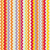 Chevron seamless colorful vector pattern or tile background with zig zag red, purple, yellow, pink and orange stripes. — Stock Vector
