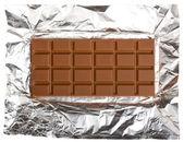 Chocolate bar on foil — Stock Photo