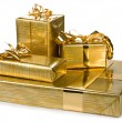 Golden gift boxes with gold ribbon — Stock Photo #14565533
