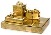 Golden gift boxes with gold ribbon — Stock Photo