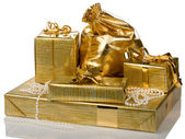 Golden gift boxes and bag — Stock Photo