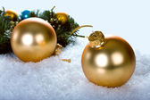 Golden christmas balls with branch christmas tree — Stock Photo