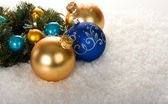 Gold and blue christmas balls with branch — Stock Photo