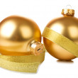 Golden balls with ribbon — Stock Photo