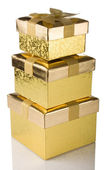 Stack of golden gift boxes — Stock Photo