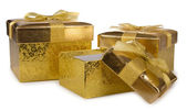 Gift golden boxes — Stock Photo