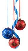 Christmas balls hanging on ribbons — Stock Photo
