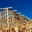 Abstract of New Home Construction Site Framing — Stock Photo #26712547