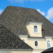Attic window on the gray tile roof — Stock Photo