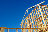 Wooden house frame against blue sky — Stock Photo