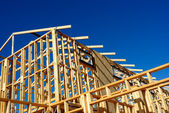 Abstract of New Home Construction Site Framing — Stock Photo