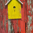 Birdhouse on rustic wooden fence — Stock Photo #28719233