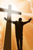 Silhouette of a man at the cross — Stock Photo