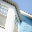 House details against blue sky — Stock Photo #32069527