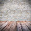 White brick wall with wooden floor — Stock Photo