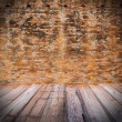 Red brick wall  with wooden floor — Stock Photo